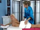 Brunette hottie massages stunning platinum blonde lezzie